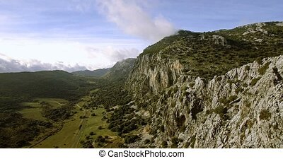 4K Aerial, Flight along a mountain range in Parque Natural...