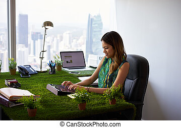 Environmentalist Woman Types Email With Tablet On Office...