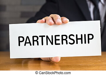 Partnership, message on white card and hold by