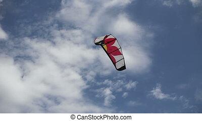 kitesurfing at sunny day - man kitesurfing at summer day