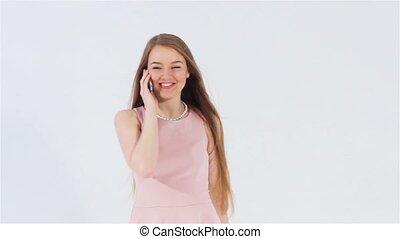 Smiling girl talking phone