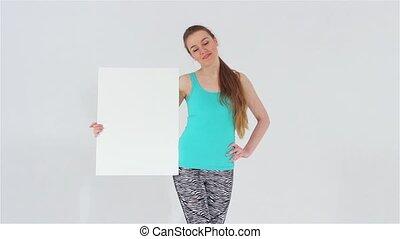 Sports girl holding white banner