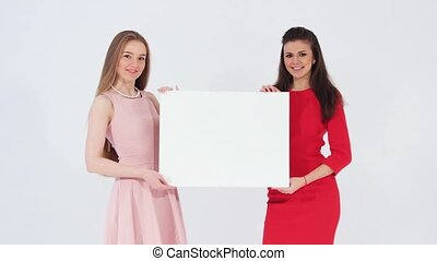 Two girls holding white banner