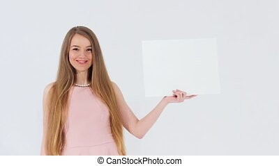 Girl holding white banner