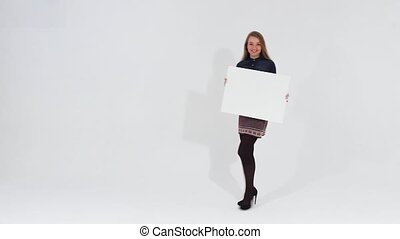 Girl walking with blank banner