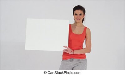 Sports girl holding white banner