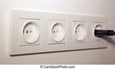 Inserting a Socket Electrical Plugs - Plugging a electrical...