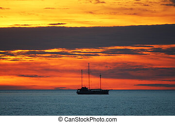 Tropical sunset - Ship on the ocean with a great sunset