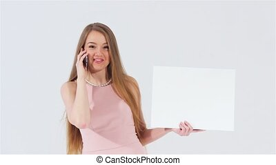 Girl talking phone with placard