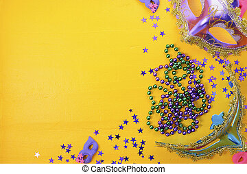 Mardi Gras masks with party decorations.