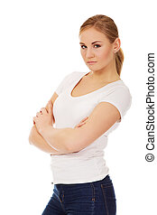 Worried young woman with folded arms