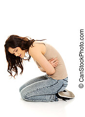 Woman suffering from severe pain in her tummy - Young...