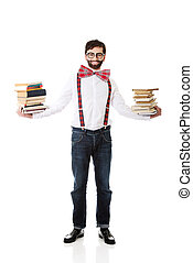 Man wearing suspenders with stack of books - Handsome man...