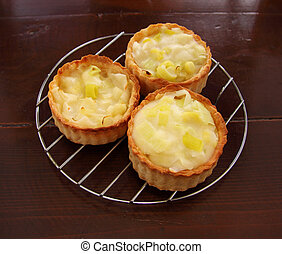 Cheesy Leek Tarts - Fresh baked cheese and leek tarts ready...