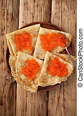 Salty snack for Shrovetide - Pancakes with red caviar at...