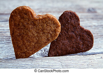 2 heart-shaped Valentines Day cooki