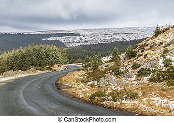 Snowy white landscape with a winding road in Wicklow Gap in...
