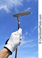 Golfer Holding a Putter - Golfer Wearing a Golf Golf Holding...