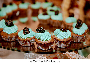 cupcakes Tiffany color with delicious cream and berry