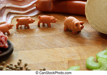 Miniature pigs surrounded by pork meat