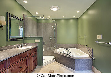 Master bath with green walls - Master bath in suburban home...