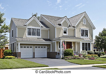 Suburban home with front porch and cedar roof