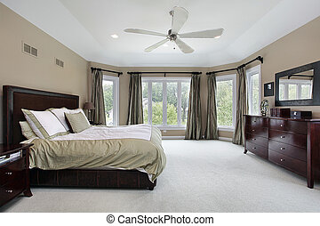 Master bedroom with wall of windows - Master bedroom in...