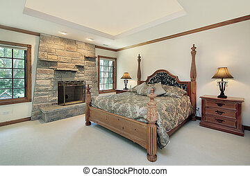 Master bedroom with stone fireplace