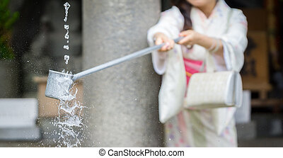 Water purification at entrance of Japanese temple 3 - Woman...