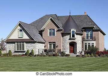 Luxury home with turret - Luxury brick, stone and cedar home...