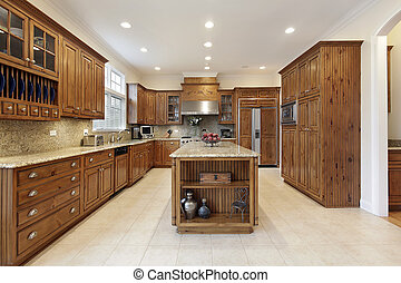 Kitchen with large granite island - Kitchen in luxury home...