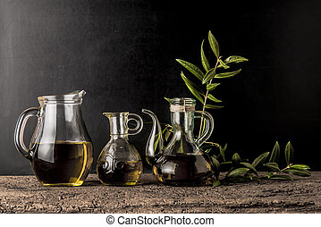 Extra virgin olive oils on rustic background