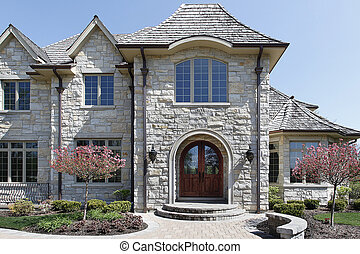 Entry way with rounded door - Entry way of luxury stone home...