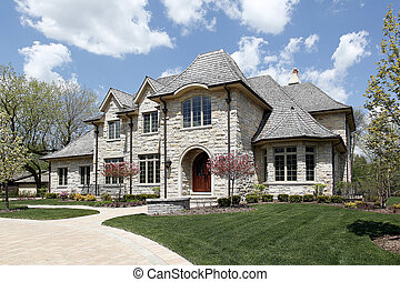 Luxury stone home with rounded entry way