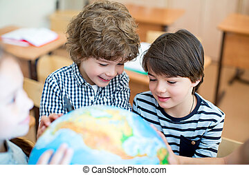 Schoolboys - Boys with a globe in classroom