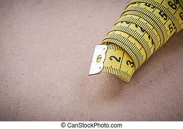 Measuring flexible ruler on vintage background