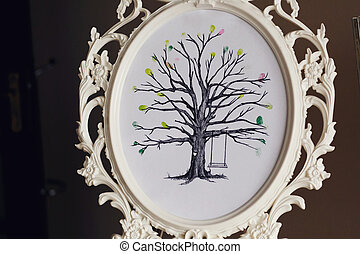Unique tree black and white drawing with swings in romantic carved white frame close-up