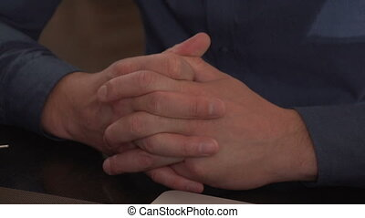 Men's hands clasped in the lock, close-up