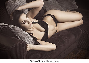 alluring female lying on sofa