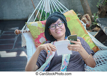 portrait of beautiful asian woman relaxing time reading book
