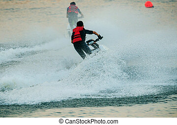 jet ski - children playing standing jet ski in fresh water...