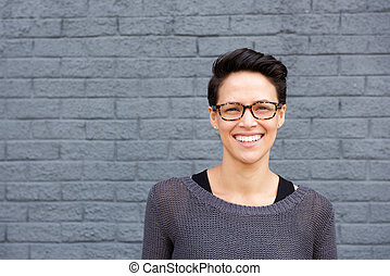 Attractive young woman smiling with glasses - Close up...