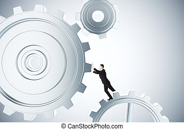 To make business work concept with businessman spinning...