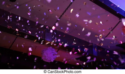 confetti pours from the ceiling at the party