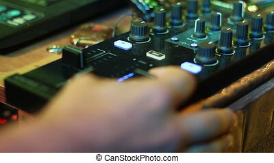 sound engineer at the console at the party