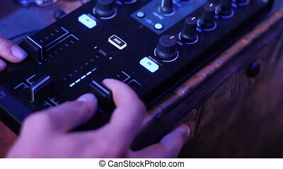 hands of sound engineer at the console - sound engineer at...