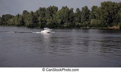 Motor Boat Floats on the River - Powerboat white sails on...