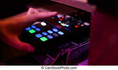 shot of DJ behind the decks at a party