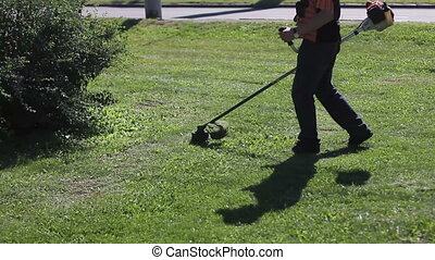 Lawnmower during the workday - Lawnmower on the work at...