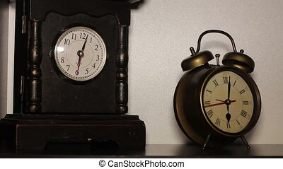 old clock on the table - old clock and alarm clock on the...